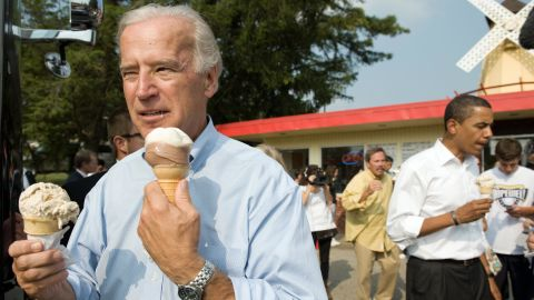 US vice presidential nominee Senator Joe Biden (L) and Democratic presidential nominee Senator Barack Obama (R) enjoy ice cream cones as they speak with local residents at the Windmill Ice Cream Shop in Aliquippa, Pennsylvania, August 29, 2008. AFP PHOTO / SAUL LOEB (Photo credit should read SAUL LOEB/AFP/Getty Images)