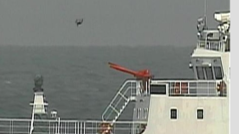 A picture released by Japanese coast guard shows a drone over a Chinese coast guard ship which Japan says was it its territorial waters
