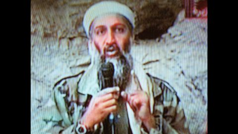 """Al Qaeda leader Osama bin Laden is seen at an undisclosed location in this television image broadcast on October 7, 2001. Bin Laden praised God for the Sept. 11 attacks and swore America """"will never dream of security"""" until """"the infidel's armies leave the land of Muhammad."""""""