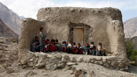 Afghan students recite Islamic prayers at an outdoor classroom in the remote Wakhan Corridor on September 2, 2007.