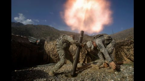 US soldiers fire mortars from a base in Afghanistan's Kunar Province on October 24, 2009.