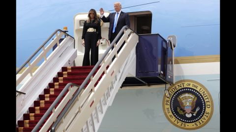 The President and first lady wave from Air Force One after landing in Riyadh.