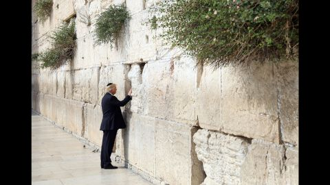 """Trump touches the Western Wall, Judaism's holiest prayer site, while in Jerusalem on May 22. Trump became <a href=""""http://www.cnn.com/2017/05/22/politics/trump-israel-western-wall/"""" target=""""_blank"""">the first sitting US president to visit the wall.</a>"""
