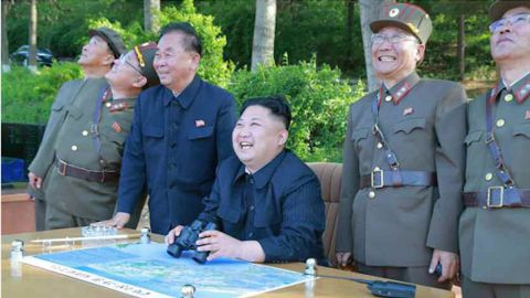 """""""The Supreme Leader issued an order to launch the missile at the observation post. Together with officials, he analyzed the results of the test launch and expressed his great satisfaction over them, saying it is perfect,"""" the Korean Central News Agency reported."""