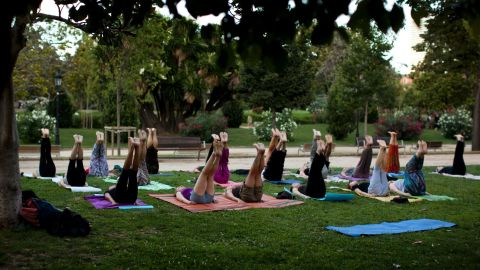 Men and women take part in an exercise class in a public park in Barcelona, Wednesday, July 20, 2011. (AP Photo/Emilio Morenatti)