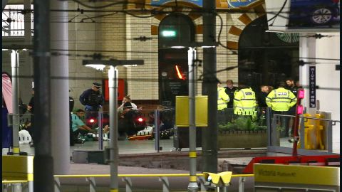 """People receive medical attention at a railway station close to the arena. The incident happened shortly after Grande had left the stage, shortly after 10:30 p.m. (5:30 p.m. ET) according to eyewitnesses. Calvin Welsford, an 18-year-old concertgoer, said that he heard a """"loud bang"""" a couple of minutes after Grande's set had finished."""