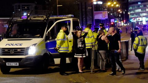 """People gather outside the arena. """"We can confirm there was an incident as people were leaving the Ariana Grande show last night,"""" police said on Twitter early on Tuesday. """"The incident took place outside the venue in a public space. Our thoughts and prayers go out to the victims."""""""