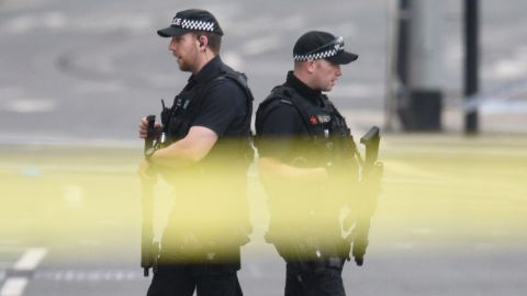 Armed police patrol near Manchester Arena following a deadly terror attack in Manchester, northwest England on May 23, 2017. Twenty two people have been killed and dozens injured in Britain's deadliest terror attack in over a decade after a suspected suicide bomber targeted fans leaving a concert of US singer Ariana Grande in Manchester. / AFP PHOTO / Oli SCARFF        (Photo credit should read OLI SCARFF/AFP/Getty Images)