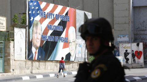 A Palestinian security official takes position before the arrival of Trump's convoy in Bethlehem, West Bank.