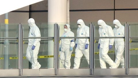 Police forensic officers leave the Manchester Arena as they investigate the scene of an explosion on May 23, 2017 in Manchester, England. An explosion occurred at Manchester Arena as concert goers were leaving the venue after Ariana Grande had performed. Greater Manchester Police are treating the explosion as a terrorist attack and have confirmed 22 fatalities and 59 injured.