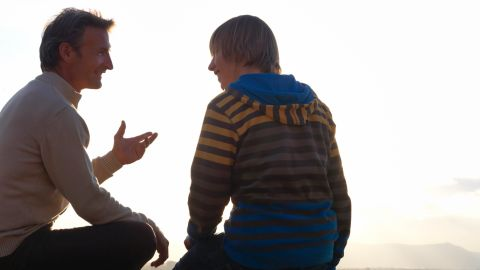 A father talking with his son.
