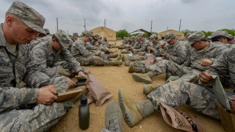 """Heard of MREs, or """"meals ready to eat""""? These Air Force recruits are being introduced to their future """"eat on the job"""" chow at Joint Base San Antonio-Lackland in Texas."""