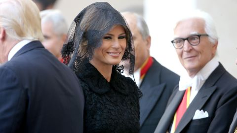 """Melania Trump arrives at the Vatican, where she and her husband met Pope Francis in May 2017. <a href=""""http://www.cnn.com/2017/05/24/politics/melania-trump-pope-francis-headscarf-fashion/index.html"""" target=""""_blank"""">With Vatican protocol in mind,</a> she wore a black veil and a long-sleeved black dress draped down to her calf."""