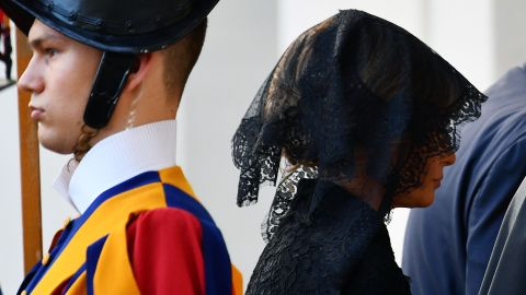 """Melania Trump arrives at the Vatican on May 24. <a href=""""http://www.cnn.com/2017/05/24/politics/melania-trump-pope-francis-headscarf-fashion/index.html"""" target=""""_blank"""">With Vatican protocol in mind,</a> she wore a black veil and long-sleeved black dress draped down to her calf. Ivanka Trump wore a similar outfit with a larger veil."""