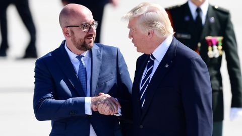 US President Donald Trump (R) shakes hands with Belgian Prime Minister Charles Michel (L) upon arrival at Brussels International Airport  on May 24, 2017. US President Donald Trump arrived in Brussels ahead of his first talks with NATO and European Union leaders.  / AFP PHOTO / Emmanuel DUNAND        (Photo credit should read EMMANUEL DUNAND/AFP/Getty Images)
