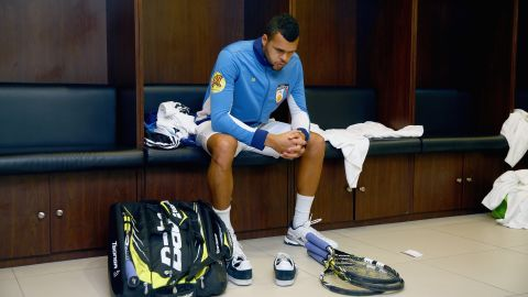 """""""There is such a thing as locker room power,"""" former British Davis Cup player Arvind Parmar told CNN Sport.  Here Frenchman Tsonga of the Manila Mavericks gets ready in the locker room before his team's match against the Singapore Slammers during the Coca-Cola International Premier Tennis League at the Mall of Asia Arena in November 2014."""