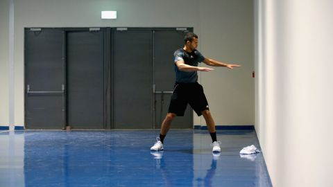 """As the old saying goes: """"By failing to prepare, you are preparing to fail."""" Jo-Wilfried Tsonga is pictured warming up at the Hamdan Sports Complex in Dubai in 2014."""