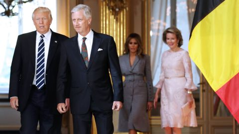 Trump speaks with King Philippe of Belgium as Queen Mathilde and Melania Trump chat during a reception at the Royal Palace in Brussels on Wednesday, May 24.