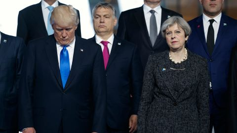 President Donald Trump stands with British Prime Minister Theresa May during a group photo with NATO leaders at the new NATO headquarters, Thursday, May 25, 2017, in Brussels. (AP Photo/Evan Vucci)