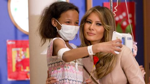 A girl takes a selfie with Melania Trump at a children's hospital in Brussels on May 25.