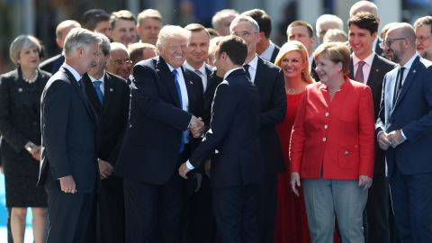 """Trump shakes hands with Macron in Brussels, Belgium, on Thursday, May 25. They were attending <a href=""""http://www.cnn.com/2017/05/25/politics/trump-nato-financial-payments/"""" target=""""_blank"""">a NATO summit</a> as the alliance officially opened a new $1 billion headquarters."""