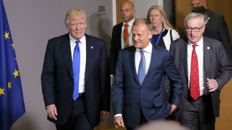 Trump walks with European Council President Donald Tusk, center, and European Commission President Jean-Claude Juncker, right, after they met at the European Council in Brussels on May 25.