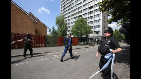 A Manchester road is closed off as police raids continued on May 25.
