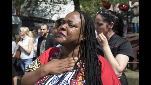 A women sheds tears after observing the minute of silence in St. Ann's Square.