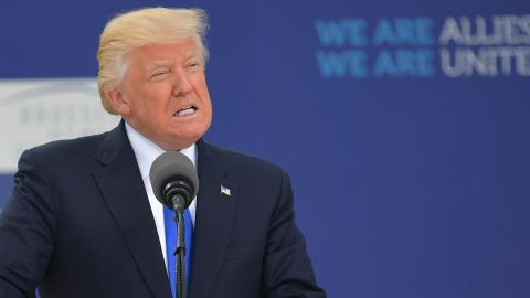 US President Donald Trump delivers a speech next to NATO Secretary General Jens Stoltenberg during the unveiling ceremony of the Berlin Wall monument, during the North Atlantic Treaty Organization summit at the NATO headquarters, in Brussels, on May 25, 2017.