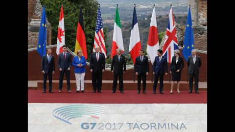 Trump and other leaders pose for a group photo at the G-7 summit on May 26. From left are European Council President Donald Tusk, Canadian Prime Minister Justin Trudeau, German Chancellor Angela Merkel, Trump, Italian Prime Minister Paolo Gentiloni, French President Emmanuel Macron, Japanese Prime Minister Shinzo Abe, British Prime Minister Theresa May and European Commission President Jean-Claude Juncker.