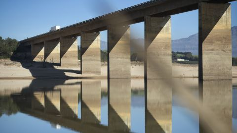 A truck crosses a bridge on May 10 at Theewaterskloof Dam. Bridge supports show previous high water marks.