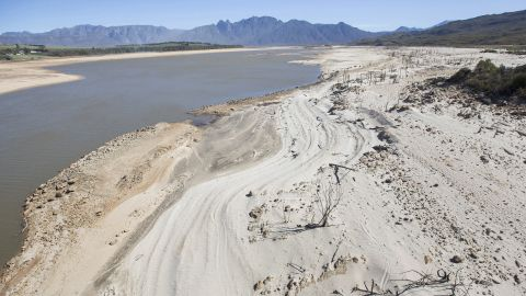 Dry sand bakes in the sun on April 16, 2017, at the Theewaterskloof Dam, a key source of water to Cape Town, South Africa.