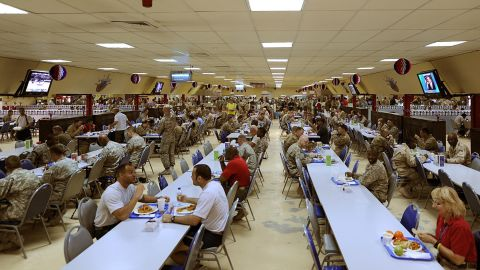 """Around the world, US military and civilians can join together in massive mess halls, like this one in Afghanistan, filled with healthy hot and cold meal options. <br />""""Military dining facilities are required to provide a large variety of foods,"""" says certified nutrition specialist <a href=""""https://www.usuhs.edu/faculty-staff/patricia-deuster-phd-mph"""" target=""""_blank"""" target=""""_blank"""">Patricia Deuster</a>, professor at the Uniformed Services University and author of the first US Navy SEAL Nutrition guide. """"You could pick from items such as beef and broccoli stir fry with rice, salads, burgers and fries or a pizza."""""""