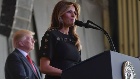 US first lady Melania Trump address US military personnel and families at Naval Air Station Sigonella as US President Donald Trump stands on stage, after G7 summit of Heads of State and Government, on May 27, near Taormina in Sicily.