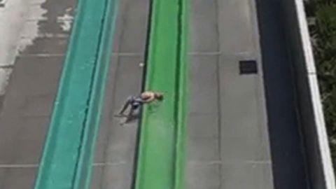 Boy falls off water slide