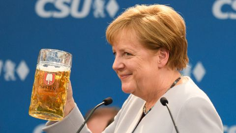 German Chancellor and Chairwoman of the German Christian Democrats (CDU) Angela Merkel holds a beer mug after her speech at the Trudering fest on May 28, 2017 in Munich, Germany.