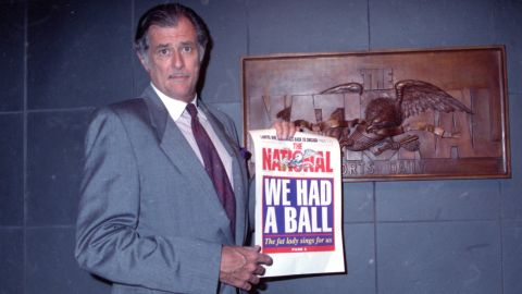 """<a href=""""http://money.cnn.com/2017/05/29/media/frank-deford/index.html"""" target=""""_blank"""">Frank Deford</a>, a renowned sportswriter and commentator, died May 28 at the age of 78. Here, Deford holds the final front page of The National Sports Daily when it folded in 1991. Deford was well known for his NPR commentaries as well as his decades-long career at Sports Illustrated."""