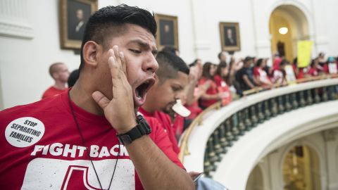 Pedro Paredes joins hundreds of protesters lining the balconies of the state Capitol rotunda in Austin on Monday.