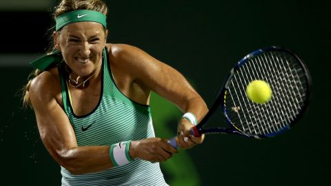 KEY BISCAYNE, FL - MARCH 31:  Victoria Azarenka of Belarus returns a shot to Angelique Kerber of Germany during the semifinals of the Miami Open presented by Itau at Crandon Park Tennis Center on March 31, 2016 in Key Biscayne, Florida.  (Photo by Matthew Stockman/Getty Images)