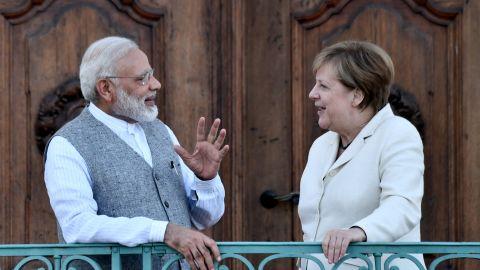 German Chancellor Angela Merkel (R) talks with Indian Prime Minister Narendra Modi at Mesberg palace near Berlin, on May 29, 2017.   / AFP PHOTO / John MACDOUGALL        (Photo credit should read JOHN MACDOUGALL/AFP/Getty Images)