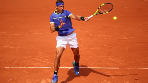 """Nadal debuted his strong blue look against Benoit Paire in the first round and the King of Clay went on to complete """"'La Decima"""" of 10 Roland Garros titles."""