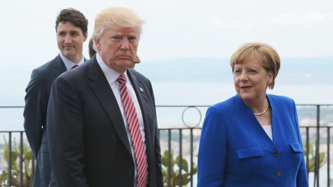 US President Donald Trump (L) walks along with German Chancellor Angela Merkel at the Belvedere of Taormina during the Summit of the Heads of State and of Government of the G7 on May 26, 2017 in Sicily.(Mandel Ngania/AFP/Getty Images)
