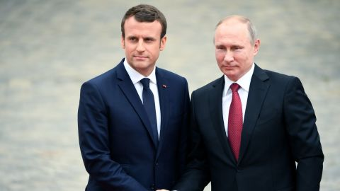 Russian President Vladimir Putin (R) is welcomed by French President Emmanuel Macron (L) as they shake hands at the Versailles Palace, near Paris, on May 29, 2017, ahead of their meeting. French President Emmanuel Macron hosts Russian counterpart Vladimir Putin in their first meeting since he came to office with differences on Ukraine and Syria clearly visible. / AFP PHOTO / CHRISTOPHE ARCHAMBAULT        (Photo credit should read CHRISTOPHE ARCHAMBAULT/AFP/Getty Images)