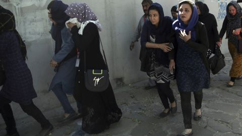 """Office workers leave the site of the suicide attack. German Foreign Minister Sigmar Gabriel said the attack was """"aimed at civilians and those who are in Afghanistan to work with the people there for a better future of the country."""""""