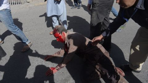 An injured man receives aid following the attack.