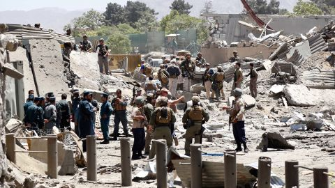 """German and Afghan authorities inspect the scene of the blast. German Foreign Minister Sigmar Gabriel said the attack was in the """"immediate vicinity"""" of the nation's embassy. """"In the attack, officials of the German Embassy were also injured. In the meantime, all employees are safe,"""" Gabriel said."""