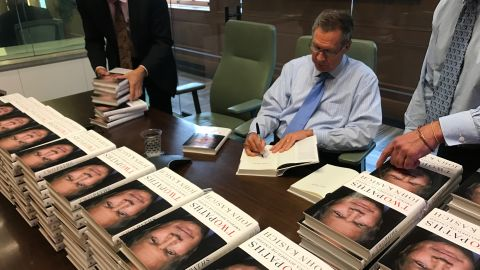 """Ohio Gov. John Kasich signs copies of his book """"Two Paths: America Divided or United"""""""