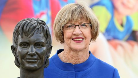 Margaret Court poses with a bronze bust of herself during the 2015 Australian Open at Melbourne Park on January 29, 2015.