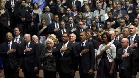 Kennedy joins the President and other officials at a memorial for the victims of a shooting in Tucson, Arizona, in 2011.