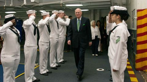 Kennedy is saluted by sailors as he tours the USS John C. Stennis in 2015.